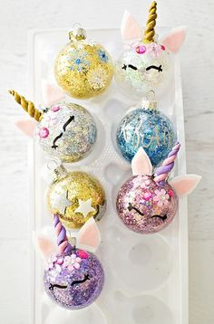 DIY Glitter Unicorn Ornaments. Find out how to easily glitter ornaments and turn them into unicorns. #unicorncrafts #diyornaments #kidscrafts