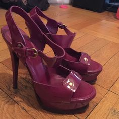 "Yves Saint Laurent Patent Tributes. Magenta color. High platform heels. Moderately worn. Heels ""5.5"" platform is ""1.25"" gold hardware and gold buckle. Slight nick on back right heel to patent. Yves Saint Laurent Shoes Sandals"