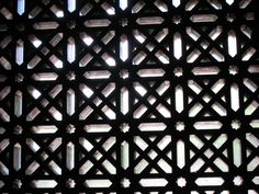 Great Mosque of Córdoba -- window screen.   The building was a mosque and all the Moorish decorative elements remain but was turned into a cathedral after the expulsion of the Moors from Spain.