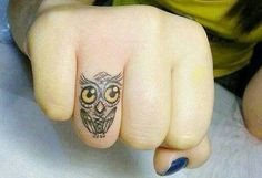 tiny owl tattoo