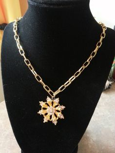 Check out this item in my Etsy shop https://www.etsy.com/listing/213256751/handmade-rhinestone-snowflake-necklace