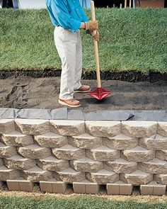 How to Build a Retaining Wall Retaining wall in the back yard.actually, will probably need a couple so we can build terraces and make the hilly back yard usable space.