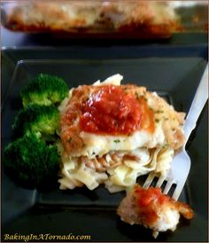 Baked Crispy Chicken Parmesan is full of classic Italian flavors, baked to a crispy crunch, topped with gooey melted cheese and served with marinara sauce. | Recipe developed by www.BakingInATornado.com | #recipe #chicken #dinner