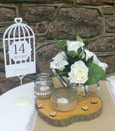 Cream flowers in a small silver watering can