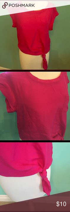 Fuschia pink 100% silk cap sleeve blouse S Bright pink silk tie at waist blouse size small. The tie can be adjusted to fit you. Cute with jeans or under a suit. Great condition and always dry cleaned. From pet free and smoke free home. Tops Blouses