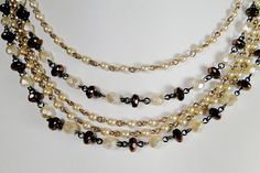 "Champagne Pearl Smooth Bronze Necklace    Champagne pearl smooth round pearls with milky champagne fire polish and bronze faceted puffy rondelle beads with luxury gold fasten clasp.    21"" long."