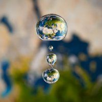 Earth as it is within a droplet of water.