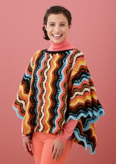 Free Crochet Pattern: Vertical Ripple Poncho  Lion Brand® Vanna's Choice® Baby - Vanna's Choice®  Pattern #: L10570   ~thinking about trying this 'snuggle' size~ be more like a wearable blanket.