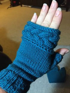Free Knitting Pattern for Mistress Beauchamp's Mitts - Jill Bickers' fingerless mitts with cable trim were inspired by gauntlets worn by Claire in the Outlander series.