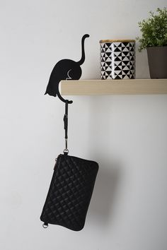 one shaped as a dancer, the other as a cat; israeli studio artori design has developed a series of silhouette hangers that will subtly enhance your living space and/or kitchen.