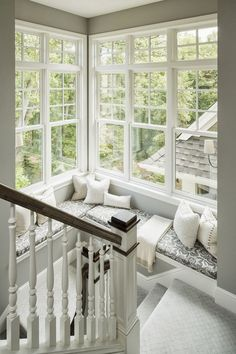Window seat on staircase landing. LOVE having tons of windows for the natural light. Love this idea!!