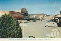 """<span class=""""caption-caption"""">Section of business centre, Currie Street, Nambour</span>, c1958. <br />Postcard folder by <span class=""""caption-publisher"""">Sydney G Hughes Pty Ltd</span>, collection of <span class=""""caption-contributor"""">Centre for the Government of Queensland</span>."""