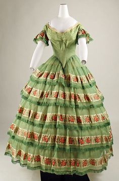 Silk and sheer silk a disposition with coordinating fichu, American, ca 1856. Evening bodice, short bx pleated sleeves, box pleated skirt with 5 tiers. MET