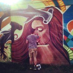 Skye Walker putting the finishing touches on his mural. @skyewalker_art @senorgrubbys @snyderart @carlsbadcagov @carlsbadvillage @cbadmag @carlsbadcrawl #skyewalker #carlsbadvillage #mural #streetart #senorgrubbys #snyderart by lauramcmillendoan