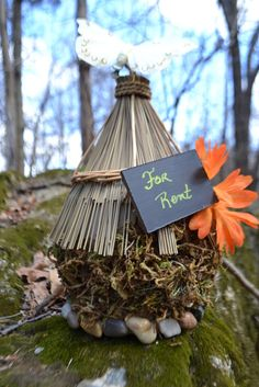 make a fairy house for rent using a bird house from craft store and glue on moss, rocks and add cute sign #diy #fairyhouse via @Catch My Party