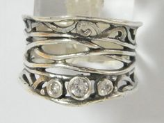 Sterling Silver Unique Wire Ring With White CZ Settings
