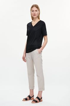This simple v-neck t-shirt is made a lyocell and cotton blend with an comfortable stretch. A boxy, relaxed fit, it has a ribbed neckline, short sleeves and neat topstitched edges.