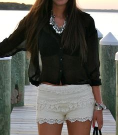 black sheer top, white lace shorts.