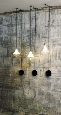 Industrial chic lighting on concrete walls.