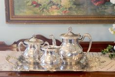 This is a lovely quadruple tea set from the turn of the century.  An antique set from the Aesthetic Period.