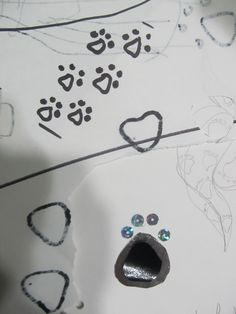 My favorite granddaughter ( our only granddaughter) requested kitty paw prints for a embellishment for her prom dress.  sounds like a good challenge. Here is what she drew for me.