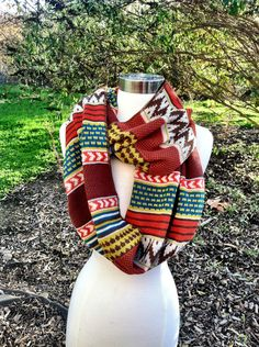 Aztec Circle Scarf Knit Sweater Infinity Scarf in Tribal Color Block Pattern Oranges, Cream and Taupe Loop Scarf. $34.00, via Etsy.