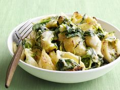 Spring Shells and Cheese    A dressed-up macaroni and cheese dish, this decadent pasta features grated zucchini, sweet shallots, fresh thyme and creamy Parmesan and Gruyere cheeses.