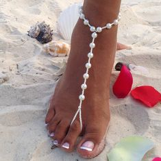 This pair of pearl barefoot sandals is simple, yet very elegant. It is made with ivory pearl beads and will be perfect for your beach wedding