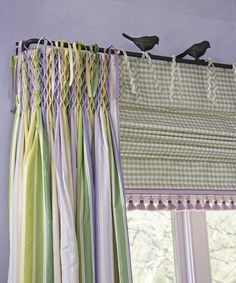 Tab Roman Shade paired with smocked drapes. ~ So adorable.
