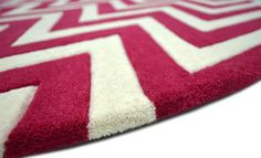 """A contemporary styled bespoke rug hand tufted with pure wool in ivory white and light crimson red. It has a pile depth of 12-14mm. Created using the """"native"""" design. [side view]"""