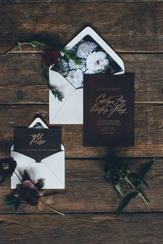 black floral invitations with gold foil - photo by Ed and Aileen Photography http://ruffledblog.com/dutch-floral-still-life-wedding-inspiration