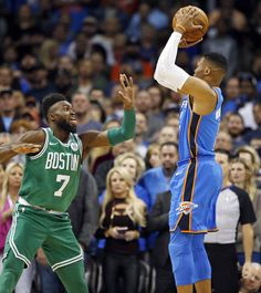 Oklahoma City's Russell Westbrook (0) shoots against Boston's Jaylen Brown (7) in the first quarter during an NBA basketball game between the Oklahoma City Thunder and the Boston Celtics at Chesapeake Energy Arena in Oklahoma City, Friday, Nov. 3, 2017. Photo by Nate Billings, The Oklahoman