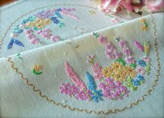 Check out this item in my Etsy shop https://www.etsy.com/uk/listing/510168789/hand-embroidered-vintage-cottage-garden