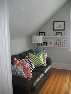 wanting a leather couch and liking the pillow idea to add color..mmmmm, wonder if I can sell the idea to Tim?