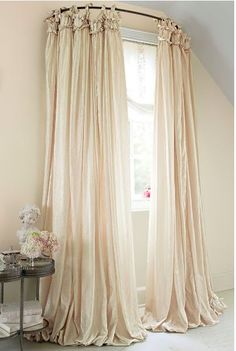 Use a curved shower curtain rod to make a window look bigger.   40 Easy DIYs That Will Instantly Upgrade Your Home
