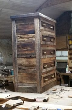 A large barn wood chest of drawers