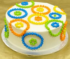Fun! Cake decorated with Sixlets candy.