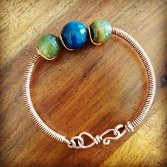 Copper+Creations+Coiled+Kada+Bracelet+with+Blue+Green+shaded+Tourmaline+beads.jpg 960×960 pixels