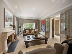 living area ideas with bi-fold doors and curtains/drapes