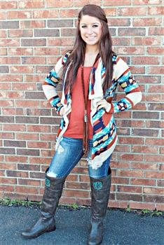 Jade, cream, and rust colored long sleeve no button a-symmetrical cardigan with an aztec print detailing throughout.