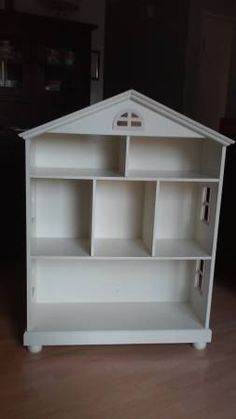 White Dolls House style with pink trim, use for books/storage or as dolls house. Great gift, very nice.