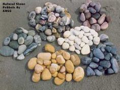 Image from http://www.bombayharbor.com/productImage/114271401622022624211different_color_natural_pebbles/Pebbles_For_Landscape_Decoration.jpg.