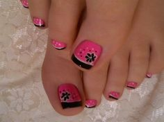Pretty pedicure: pink with black French tips and a black flower