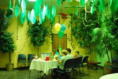 Wow a little intimidating but maybe just hanging some jungle leaves for a smaller kid's celebration...  ~  A nice dinosaur party room