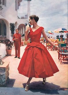 Vanity Fair, October 1955 red cocktail dress gown bow front full skirt sleeveless color photo print ad mid 50s vintage fashion style