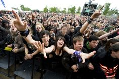 Soelvesborg, Sweden - June 2010:  Festival goers cheer during one of the live performances at the Sweden Rock Festival, June 9th-12th, 2010 ...