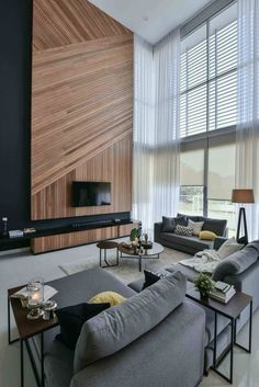 a spectacular double height space with a wooden plank wall clad diagonally and vertically for more eye catchines