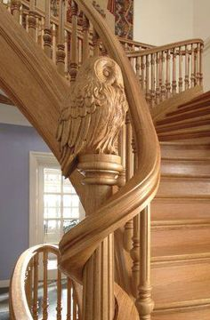 carved owl on staircase.