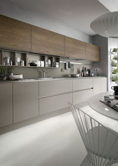 System Collection is a modern kitchen that is easy and only creates light barriers between the living areas. This model distinguishes itself by coupling technology with natural materials while the visible structures support organize and contain the worktop extends like a real working surface. This while the geometric shapes with essential lines and generous dimensions create a refined and contemporary oasis with a trenchant and luxury personality dedicated to living in the kitchen…