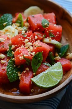Thai watermelon salad - This salad has the perfect balance of salty, sweet and spicy and is really low in calories! | scalingbackblog.com